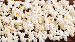 Closeup pile of white fluffy popcorn lying mixed together Stock Photos
