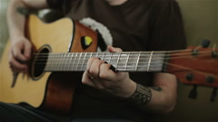 A man with tattoos playing the guitar Stock Footage