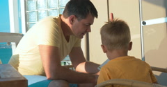 Father reading a book to little son Stock Footage