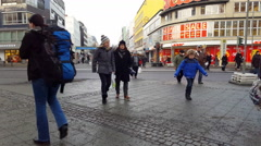 People cross big intersection, Wilmersdorfer shopping street, Berlin, Germany Stock Footage