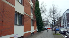 Building with climbing plant, sidewalk in Berlin, Germany Stock Footage