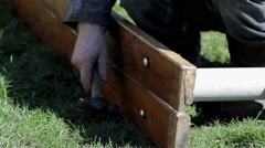 Bench fastened to the leg with a hammer Stock Footage