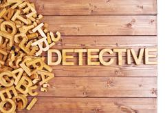 Word detective made with wooden letters - stock photo