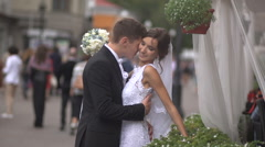 Bride and groom hugging on the street, the bride hesitate Stock Footage