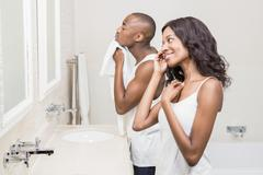 Bathroom routine for young couple Stock Photos
