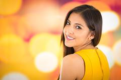 Attractive brunette wearing yellow dress posing naturally and smiling beautiful - stock photo