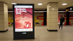 Berlinale 2016 advertisement poster in subway station, Berlin, medium shot - stock footage