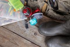 fishing tackles with fishing vest and boots - stock photo