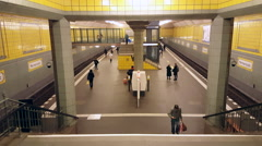 People wait for train at Hermannplatz ubahn subway station, Berlin, Germany Stock Footage