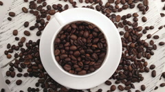 Morning coffee. Coffee magic. Roasted coffee beans turn into fragrant drink. Stock Footage