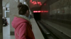 The girl awaits the arrival of the train Stock Footage