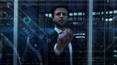 Caucasian American male oil trading using business touchscreen technology online Stock Footage