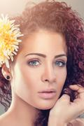 Beautiful woman with red curly hair - stock photo
