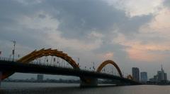 Dragon bridge during sunset at the River Hàn in Da Nang, Vietnam Stock Footage