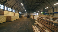 Steadicam shot: Large warehouse: where are stored the timber Stock Footage