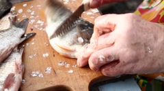 Woman cleans a fish. Evisceration of fish. Stock Footage