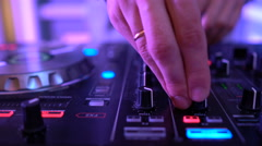Dj hands on equipment deck Stock Footage