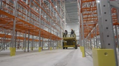 RUSSIA ST.PETERBURG- : team of installers with hard hats on Scissor Lift Stock Footage