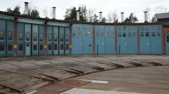 Panorama of an old locomotive garage with rail outside Stock Footage