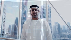 Middle Eastern Arabic male in Kandura using business touchscreen technology Stock Footage