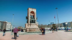 """Very busy traffic of people near the monument to the """"Republic"""" in Taksim Square Stock Footage"""