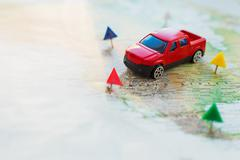 Road trip - car goes on map across the territory of the USA. The route of aut - stock photo