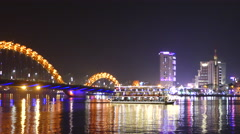 Dragon bridge with a cruise ship in the evening in Da Nang, Vietnam - stock footage