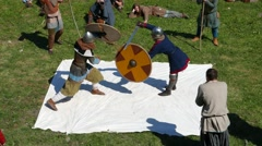 Warrior duel on swords, use round wooden shield to defend. Man aggressively rush - stock footage