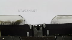 Typing STATEMENT on typewriter Stock Footage