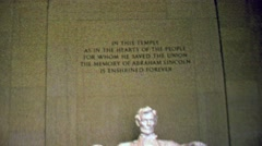 1963: Lincoln Memorial marble carved statue immutable words. Stock Footage