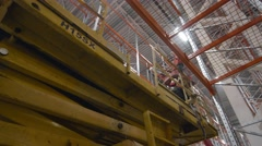 Scissor Lift work inside a new modern warehouse Stock Footage