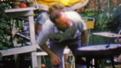 1957: Man lighting outdoor bbq grill by blowing air on the fire. Stock Footage