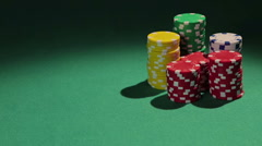 Professional poker player showing pair of aces to rival, casino chips on table Stock Footage