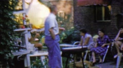 1957: Family gathering front porch standing around waiting for godot. Stock Footage
