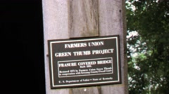 1974: Farmers Union Green Thumb Project historic covered Oldtown Bridge. Stock Footage