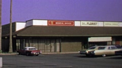 1974: Fifth avenue florist strip mall store classic car parking lot. Stock Footage