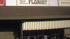 1974: Fifth Avenue Florists building front public facing open store. - stock footage
