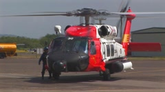 Helicopter on tarmac with pilot - stock footage
