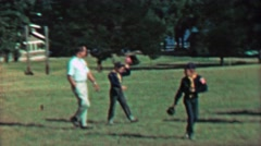 1967: Boy scouts kids and dads walking summer public park. Stock Footage