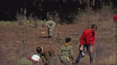 1967: Boy scouts reforestation planting trees digging holes in forest. Stock Footage