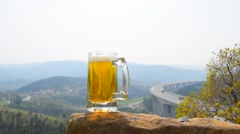 Beer mug at panoramic landscape background - stock footage