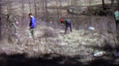 1967: Boy scout conservation work helping nature reforestation. - stock footage
