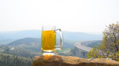 Beer mug at panoramic landscape background Stock Footage