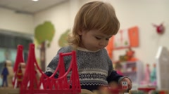 cute boy happily played with toy cars in the children's room - stock footage