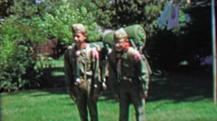 1967: Boyscouts friends loaded packs ready for big camping trip. Stock Footage