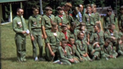 1967: Boy scout troop poses group picture lawn green outfit. Stock Footage