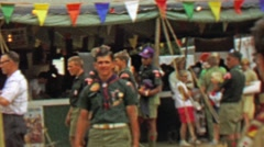 1967: Scouts marketplace public mingle area 12th World Scout Jamboree. Stock Footage
