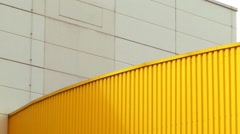 Abstract Background Yellow Metal White Concrete Blue Sky Stock Footage