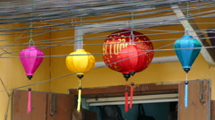Colorful lanterns behind electricity wires in the old town of Hoi An Vietnam Stock Footage