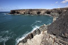 Path along the cliffs in Ajuy in the rear Caleta Negra Furteventura Canary - stock photo